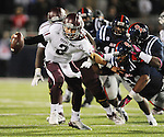 Texas A&amp;M quarterback Johnny Manziel (2) is chased by Mississippi defensive end Channing Ward (11) and Mississippi defensive lineman Issac Gross (94) in Oxford, Miss. on Saturday, October 6, 2012. Texas A&amp;M won 30-27. (AP Photo/Oxford Eagle, Bruce Newman)..