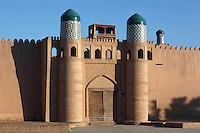 View from the front of the entrance to the Kukhna Ark or fortress, Khiva, Uzbekistan, pictured on July 6, 2010, at dawn. The Kukhna Ark is the original home of the Khans. Although its foundations are 5th century, most of the complex is 19th century. Buildings include the Summer Mosque, 1838, whose beautiful blue and white tiles were made by Ibadullah and Abdullah Jin, the old mint now housing a coin museum, and the Kurinish Khana (throne room), 1804-06, with its arcade or iwan, where audiences were held in the open air in summer and enclosed by a yurt in winter. Khiva, ancient and remote, is the most intact Silk Road city. Ichan Kala, its old town, was the first site in Uzbekistan to become a World Heritage Site(1991). Picture by Manuel Cohen.