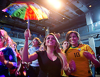 International student, Elaine Galvao, from Brazil dances with her multi-colored umbrella, a popular accessory seen in the Northeast region of Brazil during Carnaval.  .Wyman Series: Carnaval Brasileiro held in the Falcon's Nest of the University Center Thursday, February 14, 2013..photos by Kathy M Helgeson