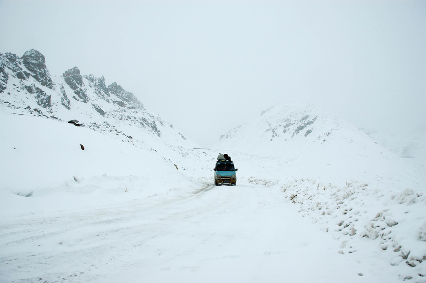 A minivan climbing the icy Chola Pass - Taken March 19, 2008 - Michael Benanav - 505-579-4046