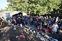 REFUGEES WAIT TO GO THROUGH  THE CROATIAN BORDER CROSSING IN SERBIA NEAR THE VILLAGE OF BERKASOVO . 24/10/2015. PHOTO BY CLARE KENDALL.