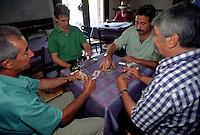 Mantova, il Bar degli Artisti, interni. Uomini giocano a carte.<br /> Mantua, the Bar of the Artists, interior. Men playing cards.