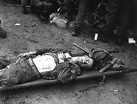 Pfc. Thomas Conlon, 21st Inf. Regt., lies on a stretcher at a medical aid station, after being wonunded while crossing the Naktong River in Korea.  September 19, 1950.  Cpl. Dennis P. Buckley.  (Army)<br /> NARA FILE #:  111-SC-348678<br /> WAR &amp; CONFLICT BOOK #:  1449
