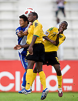Oshane Jenkins (2) and Cardell Benbow (19) of Jamaica go up for a header with Franklin Garcia (8) of Guatemala during the group stage of the CONCACAF Men's Under 17 Championship at Catherine Hall Stadium in Montego Bay, Jamaica. Jamaica defeated Guatemala, 1-0.