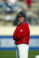April Heinrichs watches warm ups before a 0-0 tiewith Japan in San Diego, Calif.,  January 12, 2003.