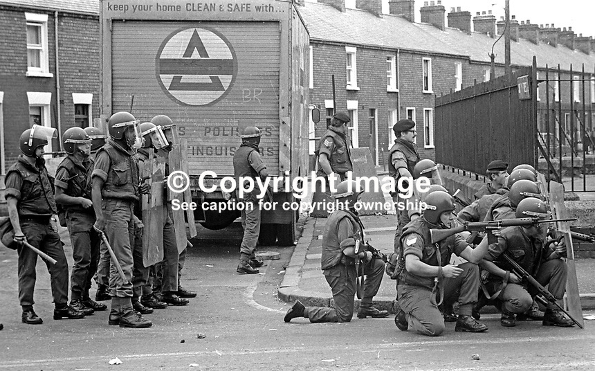 The Silver Jubilee visit of Queen Elizabeth II to N Ireland on 10th &amp; 11th August 1977 sparked serious rioting in Belfast as those opposed to the visit tried to reach the city centre. Here soldiers are ready to move into action if required. 197708100074e<br /> <br /> Copyright Image from Victor Patterson, 54 Dorchester Park, Belfast, UK, BT9 6RJ<br /> <br /> Tel: +44 28 9066 1296<br /> Mob: +44 7802 353836<br /> Voicemail +44 20 8816 7153<br /> Email: victorpatterson@me.com<br /> Email: victorpatterson@gmail.com<br /> <br /> IMPORTANT: My Terms and Conditions of Business are at www.victorpatterson.com