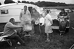 A wealthy gypsies family barbeque, with Rolls Royce and caravan, Derby Day horse race,  Epsom Downs, Surrey, England 1974.<br />