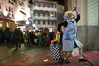 In the old town of Basel, a Fasnacht participant poses for the camera during celebrations on the first day of the Carnival of Basel in Switzerland. Feb. 23, 2015.