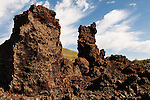 Two vertical rock formations at Craters of the Moon National Preserve.