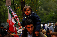 A man carries his soon while they take part of the Annual Columbus day parade in New York, United States. 08/10/2012. Photo by Eduardo Munoz Alvarez / VIEWpress.