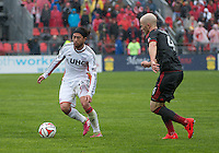 Toronto, Ontario - May 3, 2014:New England Revolution midfielder/forward Lee Nguyen #24 and Toronto FC midfielder Michael Bradley #4 in action during a game between the New England Revolution and Toronto FC at BMO Field.<br /> The New England Revolution won 2-1.