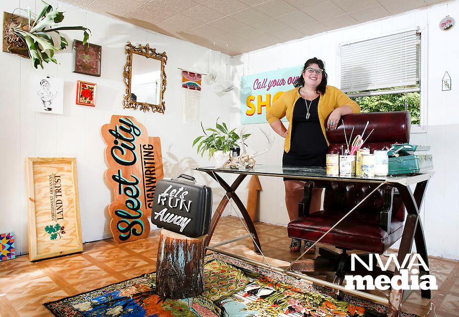 NWA Democrat-Gazette/DAVID GOTTSCHALK  Olivia Trimble stands in her favorite personal space Friday, October 2, 2015, her art and sign studio in Fayetteville.
