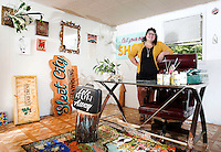 NWA Democrat-Gazette/DAVID GOTTSCHALK  Olivia Trimble stands in her favorite personal space Friday, October 2, 2015, her art and sign studio in Fayetteville.