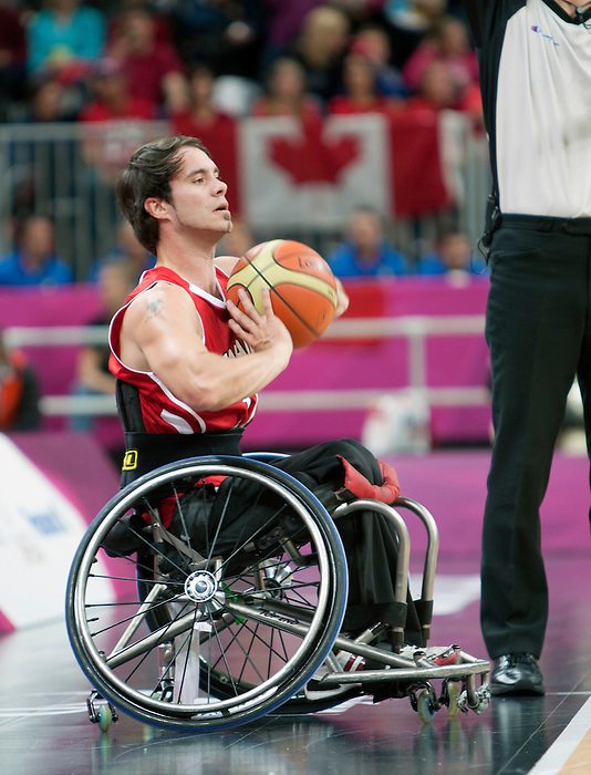 LONDON, ENGLAND 30/08/12: Chad Jassman competes in the Men's Wheelchair Basketball preliminary round CAN vs. JPN at the London 2012 Paralympic Games at the Basketball Arena (Photo by: Courtney Pollock/Canadian Paralympic Committee)