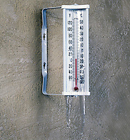 OUTDOOR THERMOMETER (F&amp;C) ON STUCCO WALL<br />