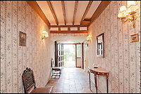 BNPS.co.uk (01202 558833)<br /> Pic: CarterJonas/BNPS<br /> <br /> ***Please Use Full Byline***<br /> <br /> A corridor in Little Easton manor. <br /> <br /> <br /> One of Britain's most historic country houses which boasts a theatre that has played host to Charlie Chaplin and H.G. Wells has gone on the market with a &pound;5 million price tag.<br /> <br /> In the early 1900s the sprawling estate's tithe barn was transformed into a theatre in which the great and the good of the acting world flocked to perform.<br /> <br /> Edwardian actress Ellen Terry gave poetry readings there while War of the Worlds author H.G. Wells, who lived with his family in a house on the estate, also frequented the theatre.<br /> <br /> Other regular performers included Charlie Chaplin, Gracie Fields and George Formby.<br /> <br /> In more recent years it has welcomed famous faces such as Rowan Atkinson, Bill Cotton, Tim Rice, Esther Rantzen and even the cast of Eastenders.<br /> <br /> The 17th century Grade II listed manor is on the market with Carter Jonas estate agents for &pound;5 million.