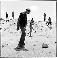 Shirat Ayam Settlement, Gaza strip Israel, Aug. 2005..Waiting for the evacuation. These teenagers throw broken glass on the road in the vain hope that it would delay the army.