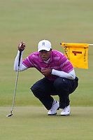 ST ANDREWS SCOTLAND. 15-07-2010. Tiger WOODS from the USA in action on the first day of The Open Championship (also known as The British Open) played on The Royal and Ancient Old Course.  Mandatory credit: Mitchell Gunn
