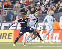 New England Revolution forward Juan Agudelo (10) attempts to control the ball as Sporting Kansas City forward Jacob Peterson (37) defends. In the first game of two-game aggregate total goals Major League Soccer (MLS) Eastern Conference Semifinal series, New England Revolution (dark blue) vs Sporting Kansas City (light blue), 2-1, at Gillette Stadium on November 2, 2013.