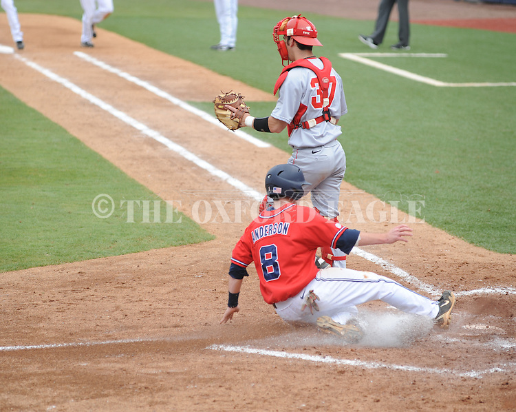 Ole Miss' Austin Anderson (8) scores vs. Houston at Oxford-University Stadium in Oxford, Miss. on Sunday, March 11, 2012. Ole Miss won 11-3 to sweep the three-game series.