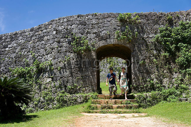 Visitors exit the main gate of Zakimi Castle ruins in Yomitan VILLAGE, Okinawa Prefecture, Japan, on May 20, 2012. Built between 1416 and 1422 by the renowned Ryukyuan militarist Gosamaru, Zakimi Castle oversaw the northern portion of the Okinawan mainland. Photographer: Robert Gilhooly