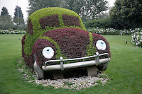 Italy. Province of Veneto. Castelnuovo del Garda.  Just outside the main entrance, a beetle Volkswagen VW car covered with grass and vegetation. The car's headlights are two eyes. Gardaland is the biggest amusement park in Italy and one of the largest in the whole of Europe. © 2006 Didier Ruef