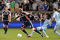 Saer Sene (39) New England forward evades the tackle from Sporting KC's Kei Kamara... Sporting Kansas City defeated New England Revolution 3-0 at LIVESTRONG Sporting Park, Kansas City, Kansas.