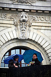 Europe, France, Paris. A couple with blue umbrellas outside the Musee D'Orsay.
