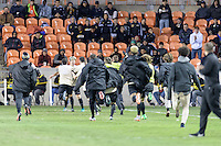 Houston, TX - Friday December 9, 2016: Wake Forest Demon Deacons players run to Ian Harkes after he scored the winning goal against the Denver Pioneers at the NCAA Men's Soccer Semifinals at BBVA Compass Stadium in Houston Texas.