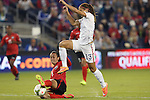 15 October 2014: Arin King (TRI) (5) tackles the ball away from Alex Morgan (USA) (13). The United States Women's National Team played the Trinidad and Tobago Women's National Team at Sporting Park in Kansas City, Kansas in a 2014 CONCACAF Women's Championship Group A game, which serves as a qualifying tournament for the 2015 FIFA Women's World Cup in Canada. The United States won the game 1-0.