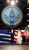 Washington, DC - January 20, 2009 -- United States President Barack Obama and First Lady Michelle Obama arrive at the Neighborhood Inaugural Ball at the Washington Convention Center on January 20, 2009 in Washington, DC. Obama became the first African-American to be elected to the office of President in the history of the United States.  .Credit: Chip Somodevilla - Pool via CNP