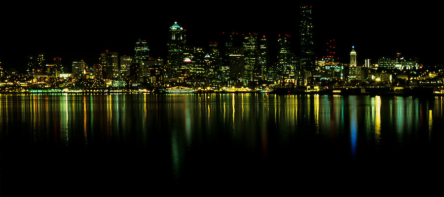 The view of Seattle at night from Alki Point in Washington State.