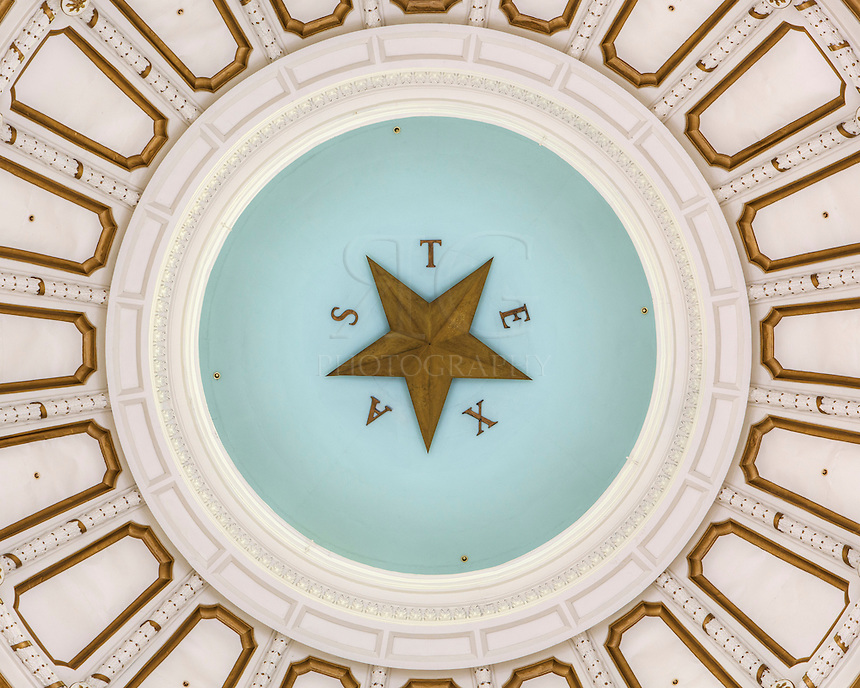 The dome of the capitol in Austin, Texas, rises to 266 feet and is highlighted with ornate architecture, culminating with an 8 foot wide Texas Star at the top. This view was taken with a telephoto lens and looks straight up from the mosaic floor of the rotunda.
