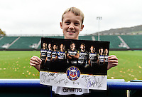 A young Bath Rugby supporter shows off his autographed print at the end of the session. Bath Rugby Captain's Run on October 30, 2015 at the Recreation Ground in Bath, England. Photo by: Patrick Khachfe / Onside Images