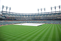 View of Comerica Park playing field covered by a rain tarp.