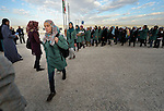 Girls line up and walk to class at a school in the Zaatari Refugee Camp, located near Mafraq, Jordan. Opened in July, 2012, the camp holds upwards of 50,000 refugees from the civil war inside Syria, but its numbers are growing. International Orthodox Christian Charities and other members of the ACT Alliance are active in the camp providing essential items and services, including school uniforms.