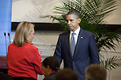 United States President Barack Obama is met by U.S. Secretary of State Hillary Rodham Clinton after addressing a meeting of the Libya Contact Group at the United Nations in New York, New York on Tuesday, September 20, 2011.  Chairman Mustafa Abdel Jalil of the Libyan Transitional National Council (TNC) and UN Secretary-General Ban Ki-Moon are in attendance..Credit: Allan Tannenbaum / Pool via CNP