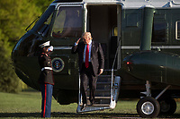 United States President Donald Trump salutes the Marine Guard as he returns to the White House after a day trip to Kenosha, Wisconsin where he visited Snap-on tools, in Washington, D.C. on April 18, 2017. <br /> CAP/MPI/RS<br /> &copy;RS/MPI/Capital Pictures