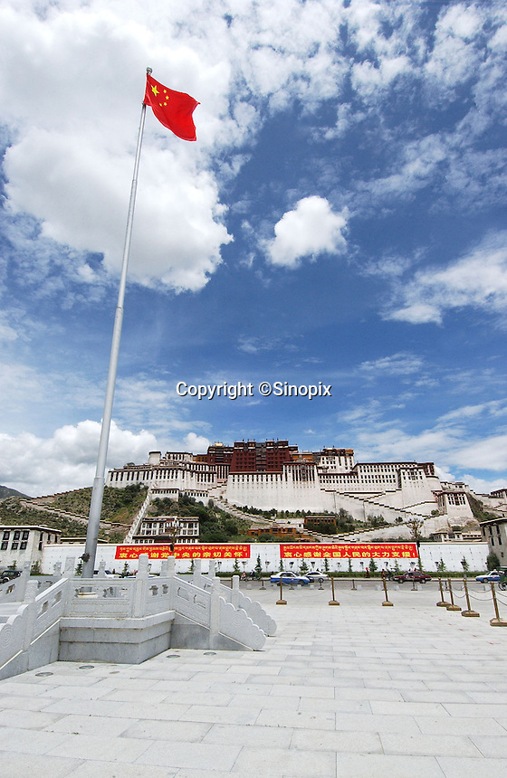 A Chinese flag flies in Potala Square, Lhasa. .13 Jul 2006