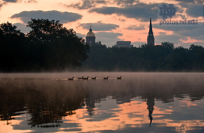 Sunrise over St. Mary's lake, late summer...Photo by Matt Cashore/University of Notre Dame