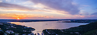 A aerial panorama as the sun set over Lake Travis outside of Austin Texas. This sunset over the lake turned out to give a colorful sky with oranges, pinks to add another spectacular evening at the lake.