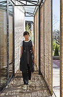 Stylist Lurdes Bergada in the entrance to her new home in the countryside outside Barcelona