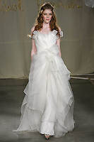 Model walks runway in a Sweet Bay Long wedding dress by Carol Hannah Whitfield, for the Carol Hannah Spring Summer 2012 Bridal collection runway show.