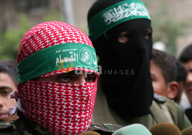 """Members of the Military Wing of Hamas  """"Izz Deen Qassam"""" hold a press conference, in Gaza City. Three Israeli soldiers and four militants have been killed as troops backed by assault helicopters stormed into the Gaza Strip."""