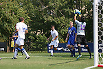 04 September 2011: SMU's Jaime Ibarra (13) grabs the ball in front of Duke's Christopher Tweed-Kent (19, white) and SMU's Adam Still (19, blue). The Southern Methodist University Mustangs defeated the Duke University Blue Devils 1-0 in overtime at Koskinen Stadium in Durham, North Carolina in an NCAA Division I Men's Soccer game.