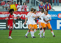 01 July 2010:  Houston Dynamo forward Joseph Ngwenya #33 is restrained by his teamates as Toronto FC midfielder Julian de Guzman #6 walks off the field after both players received a red card from referee Jair Marrufo for violent conduct during a game between the Houston Dynamo and the Toronto FC at BMO Field in Toronto..Final score was 1-1....