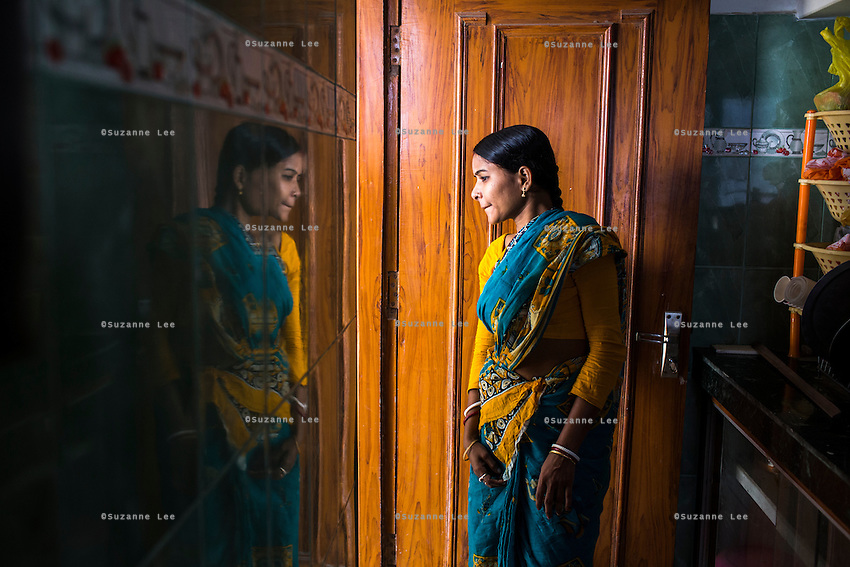 Brinda, looks out of the pantry next to her room where she is staying during a court hearing for her legal case, in the Guria office in Varanasi, Uttar Pradesh, India on 23 November 2013. One of the 57 underaged and trafficked girls rescued from the Shivdaspur red light area in Varanasi, she has been fighting a court case against her traffickers and brothel owners for the past 8 years with the help of NGO Guria Swayam Sevi Sansthan