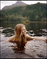 BNPS.co.uk (01202 558833)<br /> Pic: WildGuideScotland/BNPS<br /> <br /> Wild swimming in a cool loch.<br /> <br /> Scotland's stunning unspoiled scenery is being shown in a whole new light in a book that reveals the hidden gems off the beaten track north of the border.<br /> <br /> Three young photographers travelled the width and breadth of Scotland and snapped 750 picturesque places which include shimmering lochs, ancient forests, lost ruins, hidden beaches, secret islands, dramatic cliffs, tiny glens and mysterious grottoes. <br /> <br /> Friends Kimberley Grant, David Cooper and Richard Gaston, all in their late 20s, have spent the past two years exploring lesser known idyllic spots which they are keen to bring to a wider audience.