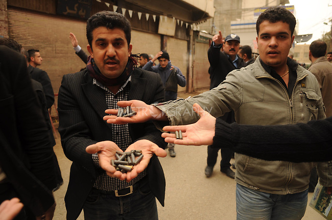 SULAIMANIYAH, IRAQ: Protesters show bullet casings from rounds the police fired...A third day of violence rocks the Iraqi Kurdish city of Sulaimaniyah.  Tensions between protesters and security forces flare after the security forces continue to use life ammunition during the demonstrations...Photo by Hawre Majid