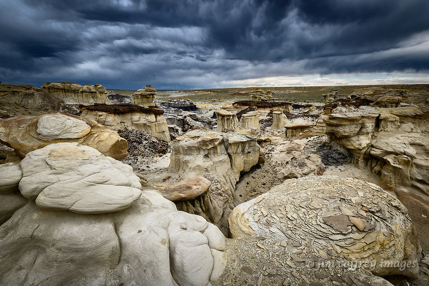 Eroded and crumbled rock formations in a small badlands area along the edge of Ah Shi Sle Pah Wash in New Mexico's San Juan Basin